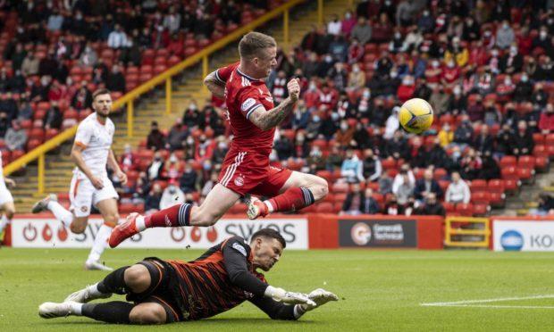 Aberdeen's Jonny Hayes scores the opener past Dundee United's Benjamin Siegrist.
