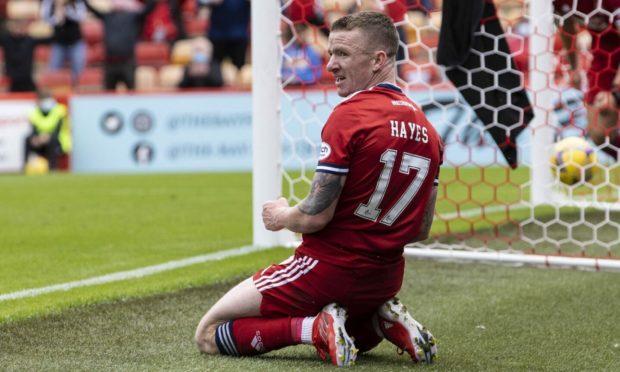 Jonny Hayes celebrates his opening goal against Dundee United