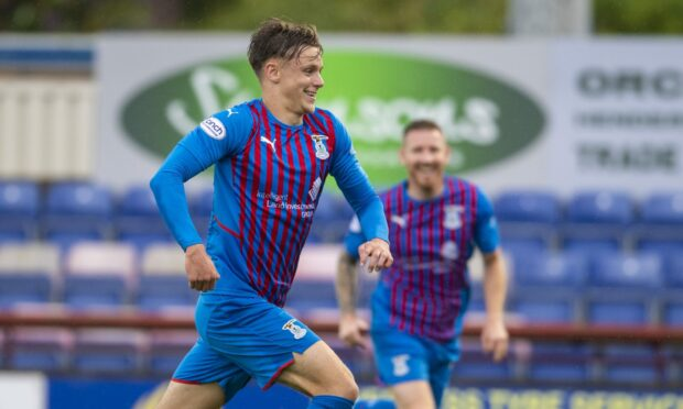 Roddy MacGregor celebrates after scoring Caley Thistle's clincher against Raith Rovers.