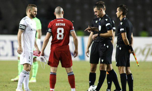 Qarabag captain Maksim Medvedev (left) with Aberdeen captain Scott Brown in the Euro tie in Baku.