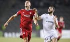 Aberdeen's Christian Ramirez (left) battles with Qarabag's Abbas Huseyno in the play-off first leg in Baku.