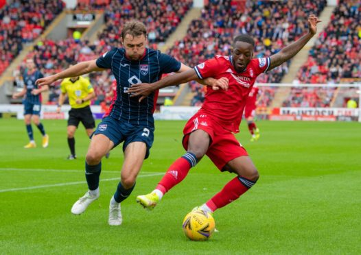 Aberdeen's Austin Samuels and Ross County's Connor Randall in action