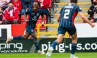 Ross County's Regan Charles-Cook celebrates after making it 1-0 against Aberdeen.