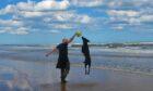 George on a walk at Balmedie beach with his beloved Sammy.