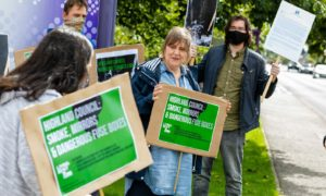 Christine Stoddart protests with others outside the Highland Council