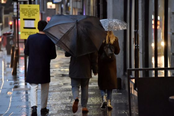 Shoppers brave the rain in Aberdeen.  Picture by KENNY ELRICK     01/11/2019