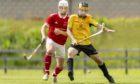 Mark MacDonald, left, in action for Kinlochshiel.