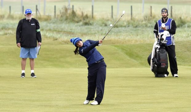 Kelsey MacDonald hits into the 18th green in the first round at Carnoustie.
