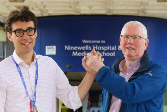 Mr Sharp is pictured with Dr Tom Gilbertson.