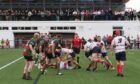 A packed crowd watched Highland defeat Aberdeen Grammar at Canal Park.