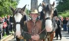 Jamie Alcock with Shire horses Millie and Willam in Elgin's Cooper Park. Photo: Jason Hedges/DCT Media