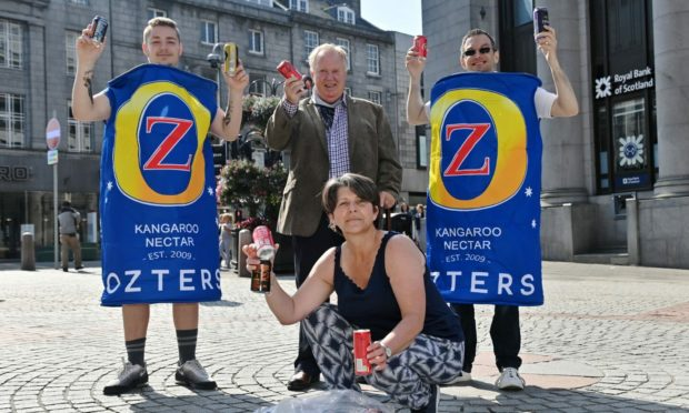 Lewis McGregor, 18, launched Cash for Cans for Aberdeen charity Future Choices On Saturday. Pictured: Councillor Marie Boulton with from left, Lewis McGregor, councillor Bill Cormie and David Forbes.