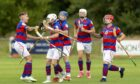 Ruaridh Anderson (2nd left) is congratulated by team mates after scoring his second goal.