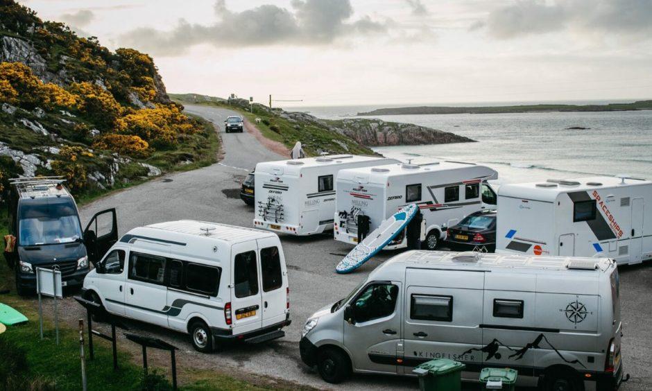 Campervans parked up at Ceannabeinne Beach, near Durness.
