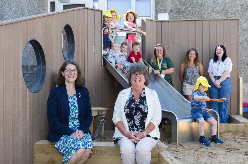 Councillor Rosemary Bruce, councillor Gillian Owen, childminder Zoe Sadler and mum, Rhona Hopkins.