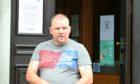 Aaron McIntyre leaving Aberdeen Sheriff Court.
