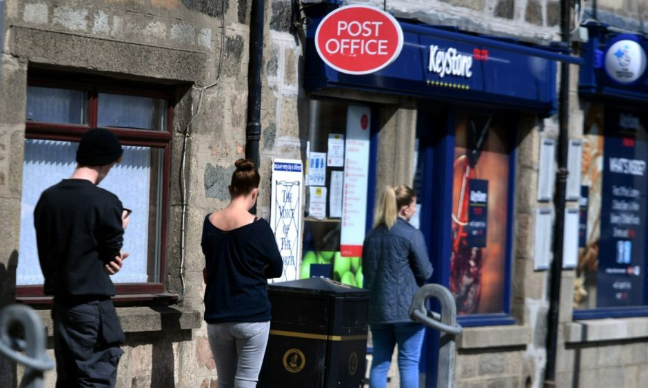 Customers queuing outside the Oldmeldrum post office in May 2020. Photo: Chris Sumner/DCT Media