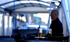 A customer enjoys a pint in the The Grill's tent in Union Street.