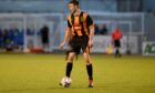 Huntly defender Michael Clark will be facing Formartine United in the Evening Express Aberdeenshire Cup