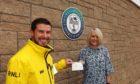 Gav Hyne (left), deputy mechanic of RNLI Buckie Lifeboat, accepts a donation of £250 from Amanda Fraser, administrator of Buckpool Golf Club.
