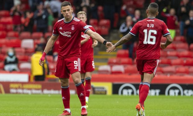 Christian Ramirez and Funso Ojo in action for Aberdeen against Ross County