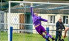 Keiran Chalmers of Strathspey scores from a free Kick, beating Wick goalkeeper Graeme Williamson.