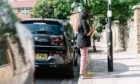 """A driver """"""""fills up"""" at a Shell-owned ubitricity charge post in London."""