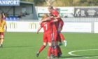 The Aberdeen players celebrate Bayley Hutchison's winner.  Picture by Wullie Marr / DCT Media