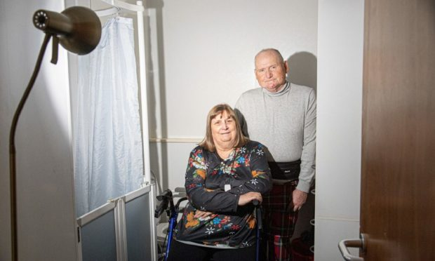 Scott and Jeannie Anderson were left without a wet room light for five weeks after the council botched a repair job on the bathroom floor upstairs. Picture by Wullie Marr