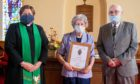 Rev Stella Campbell (left) with Edna Edmond and Gordon Argo, who presented the organist with a certificate from the Church of Scotland marking her 68 years of service. Wullie Marr / DCT Media