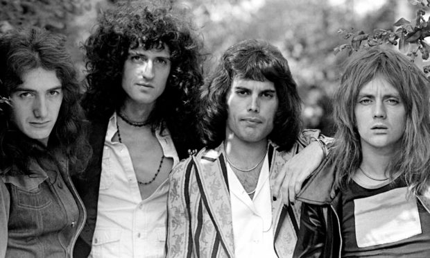 Brian May and Freddie Mercury with Queen in 1975.