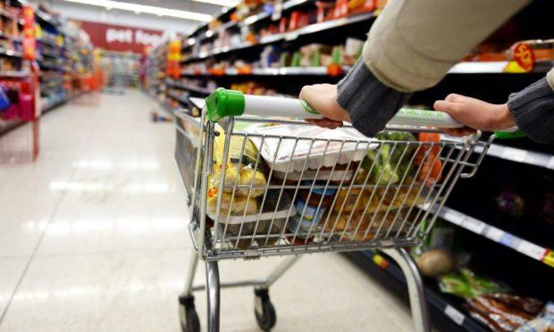 A shopper pushes a trolley in Asda .