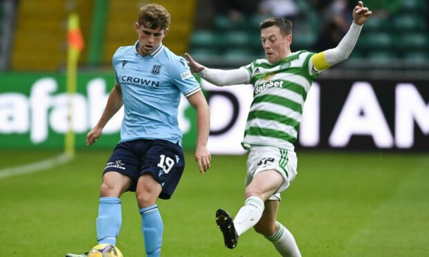 Dundee's Finlay Robertson (L) and Celtic's Callum McGregor compete in the cinch Premiership.