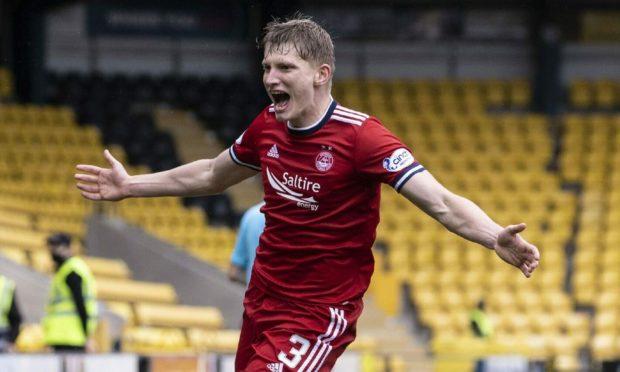 Aberdeen's Jack MacKenzie celebrates his late winner at Livingston.