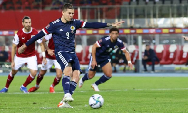 Scotland's Lyndon Dykes makes it 1-0 from the penalty spot against Austria in the World Cup qualifier.