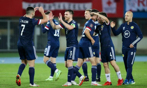 The Scotland players celebrate at full time of the 1-0 World Cup qualifier defeat of Austria.