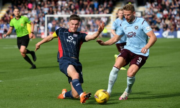 Stephen Kingsley and Blair Spittal during the cinch Premiership match between Ross County and Heart of Midlothian.