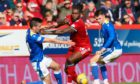 Aberdeen's Jay Emmanuel-Thomas and St Johnstone's James Brown (left) and Glenn Middleton in action.