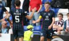 Ross County's Blair Spittal celebrates making it 2-1 with Jack Baldwin.