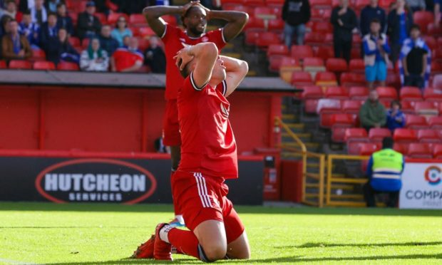 Aberdeen's Christian Ramirez holds his head after missing a chance against St Johnstone.