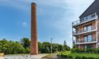 Tall order: The team at Barratt Homes worked together to restore the chimney to its former glory.