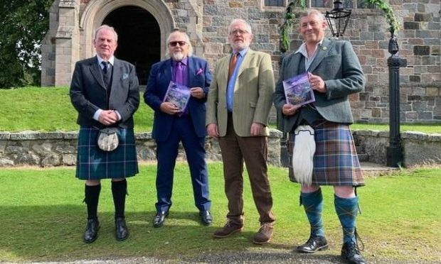 Francy Devine, John Lowrie Morrison, Rev Kenneth MacKenzie and Paul Anderson at the launch of the book about Iona, which will be presented to the Queen.