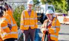 Council leader Margaret Davidson gets a tour of new full fibre network installation.