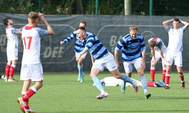 Banks o' Dee's Lachie Mcleod scores the winning goal against Turriff United. Picture by Chris Sumner