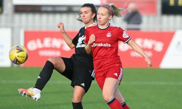 Aberdeen's Lauren Gordon battles for the ball against Hamilton Accies