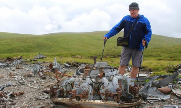 Gary Nelson at wreckage of the Vickers Wellington bomber near Muckle Cairn, Glen Clova.