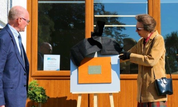 Princess Anne unveiling a plaque at the Banchory Men's Shed