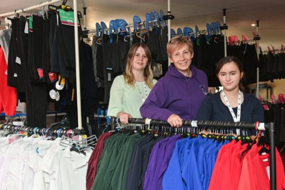 Left to right: Moray School Bank's Racheal Glennie Debbie Kelly and Mhairi Ward making up a uniform pack to go to a school pupil.