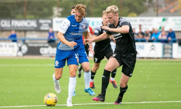 Peterhead defender Jason Brown (right) in action against Montrose.
