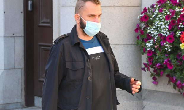Irek Witkowski leaves Aberdeen Sheriff Court.